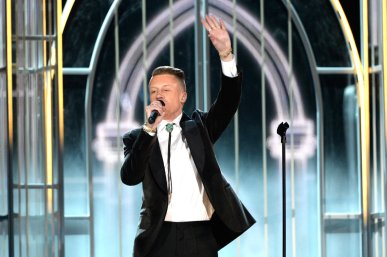 The rapper Macklemore performs onstage during the 56th Grammy Awards on Sunday. Kevork Djansezian/Getty Images
